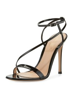 "Gianvito Rossi asymmetric strappy patent leather sandal. 4.3"" covered stiletto heel. Thin strap bands open toe. Strappy vamp. Adjustable ankle-wrap strap. Smooth outsole. Leather sole. ""Carlyle"" is ma"