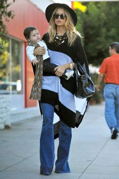 Sorry but I just love this woman.  Love that her baby is wearing a missoni scarf.