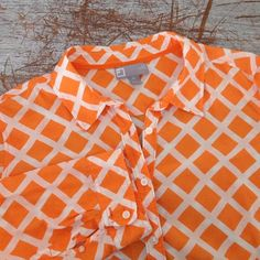 Orange Silk-Blend Button Down Top  Add this fun and bright button-down to your wardrobe this spring. Silk blend & 3/4 sleeved. No flaws! (Just too small for me *sigh*) Pictures show true color. Tag says PL but it's more of a Medium. I'll be happy to provide proper measurements upon request!! Price negotiable! ❌No Trades❌ jcpenney Tops Button Down Shirts