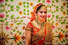 Our stunning bride adorned in polki jewellery and gold beaded maathapatti.