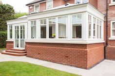 We love the contrast of this bright #R9 #orangery and the red brick of this house. #Windows #Doors #conservatories #R9journey #HomeImprovement #Living