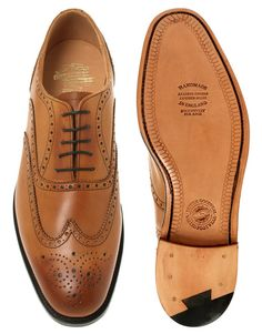 ASOS. I love men in wingtips. I had a pair myself several years ago... yes, they were women's shoes. :) Classic style.