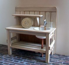 Bench and Sink One inch dollhouse scale (1:12) Bass wood construction and painted shabby white - worn areas Measures 4 long - 2 1/2 to