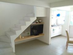 Tv under the stairs concept Staircase Storage, Staircase Design, Living Room Under Stairs, Burgundy Living Room, Cube Furniture, Modern House Floor Plans, Townhouse Interior, Estilo Interior, Small House Decorating