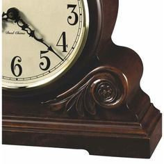 Contemporary Chiming Quartz Mantel Clock, Howard Miller 635138 Desiree. This charming mantle clock features carved leaf and rosette overlays.Aged dial offers black Arabic numerals .Quartz, dual-chime Kieninger movement plays full Westminster or Ave Maria chimes with strike on the hour. Volume control, automatic night time volume reduction option, and automatic nighttime chime shut-off option.Quartz movement Finished in Americana Cherry on select hardwoods and veneers.