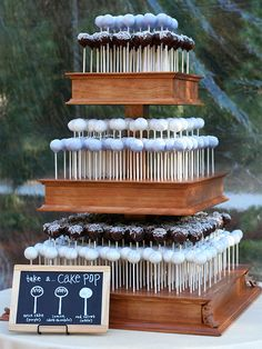 Cake pop wedding cake. Easy peasy and looks so chic. This way guests get a choice of flavour.   #alternativeweddingcake   www.foodanddrinkguides.co.uk