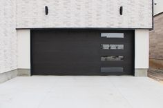 Contemporary Design Cedar Garage Door. Horizontal Inlay with Windows. Finished using Sansin custom color Stain. Oxford Carriage Door Ltd.