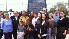 Historian Robin Krawitz (rt), Ocea Thomas (with grandsons), Robert Seeley (her rt), a descendant of abolitionish Thomas Garrett ... near the site of a farm belonging to Quaker John Hunn, who helped in the Underground Railroad.
