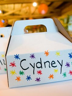 Perfect idea to entertain the nieces,nephews and other kiddos at the reception. Personalized boxes with toys and coloring stuff.
