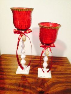 "Refurbished two old votives - holders were black so I sprayed them white and distressed them for ""shabby chic"" look."