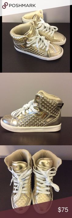Gold Zumba High Top Street Boss Sneakers Tried on but never worn. These kicks have serious sole. For the risk-takers and booty-shakers who crave style and support, the all-new Zumba Street Boss does it all. Featuring impact-protection and support that won't quit, these kicks will seriously step up your fashion game.  P.S. The Zumba Street Boss runs a bit narrow. If you're between sizes, we advise that you purchase the next size up. Zumba Shoes Athletic Shoes