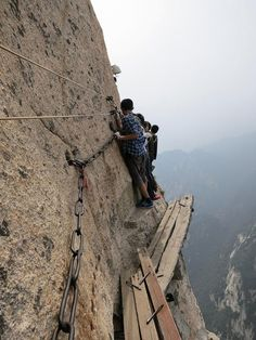 Mt. Huashan Hiking Trail, China  An adventurous group walk along the infamous plank path of the Mt. Huashan Hiking Trail.