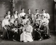 "Some more beautiful blouses. Washington, D.C., circa 1905. ""Central High School Orchestra."""
