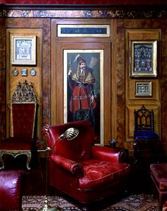 """In Mongiardino's home, his fascination with Turkish exotica, faux finishes and richly toned and patterned textiles was very much apparent. The framed works on the wall were part of his collection of miniature Neapolitan altarpieces from the 18th and 19th centuries, exquisite creations tellingly made out of """"poor materials."""" Photo by Oberto Gili"""