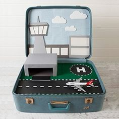 Make your little man this awesome suitcase. There are FOUR different scenes for him to play with! And it all fits in the one case!