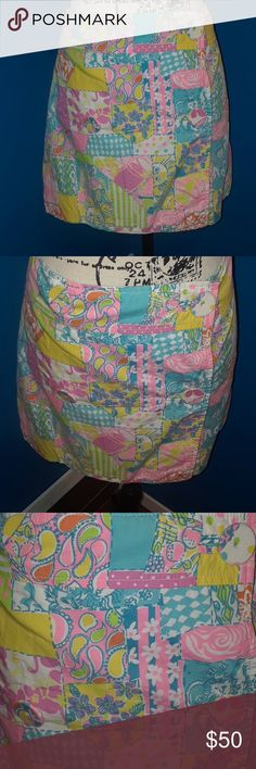 """🌼🌼Lilly Pulitzer Rare Patchwork Wrap Skirt Hard to find print Patchwork wraparound with blue lining. Large buttons on front. So cute!  Measurements:  (Approximately, laid flat) Length:  15 1/2"""" Waist:  16"""" Lilly Pulitzer Skirts"""