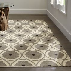 """Neutral floral motif has an open, geometric layout, updating its vintage pedigree with a fresh, cottage feel. Each flatweave rug is created on a vertical loom, which requires two skilled artisans to operate. Serged border adds a neat finish.<br /><br />Order rugs (up to 6'x9') on-line and pickup in a <a href=""""/stores/list-state.aspx"""">store near you</a>. It's fast, easy and free.<br /><br />For 8'x10' and larger rugs, order on-line and arrange a convenient warehouse pick-up or delivery.<br…"""