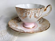 This English teacup is an artful balance of soft hued pink and rich gold lace. Salisbury Bone China created this elegant tea cup and saucer Tea Cup Saucer, Tea Cups, Rose Tea, Teapots And Cups, Tea Service, Gold Lace, Chocolate Pots, My Tea, Tea Recipes