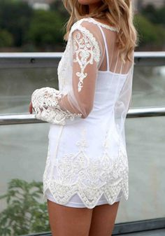 left side view of white embroidered cover up, add white leggings and we're in!