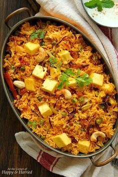 An aromatic and mildly spiced one-pot rice dish, this paneer dahi pulao (yogurt marinated paneer pilaf) is an easy option for both busy days and special nights. Paneer Recipes, Veg Recipes, Indian Food Recipes, Vegetarian Recipes, Cooking Recipes, Indian Foods, Indian Snacks, Gourmet Recipes, Cooking Tips