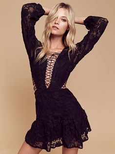Jolene Lace Up Dress | Sweet and sexy mini dress featuring pretty custom tulle embroidery allover and edgy lace-up details on the front, back and sides. Ruffled design at the hem. Hidden back zipper closure. Lined bodice and skirt.