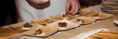 Chef preparing food on Bamblu palm leaf plates.