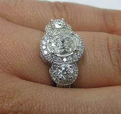Three Stone Oval Diamond Halo Engagement Ring@Nicole Pettipas