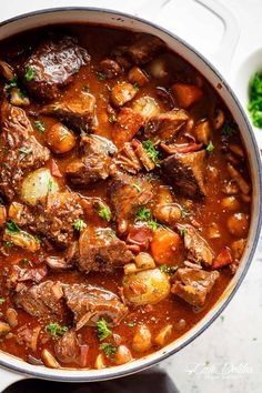 Tender fall apart chunks of beef simmered in a rich red wine gravy makes Julia Child's Beef Bourguignon an incredible family dinner. | cafedelites.com