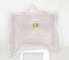 fab clear vintage | 1996 Hermes Clear Kelly bag with gilt metal turn lock hardware.