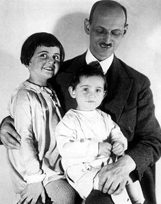 Photo Description - Otto Frank with his daughters Margot and Anne (sitting on his lap), circa 1931