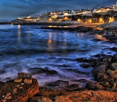 The beautiful blue ocean touching praia dos pescadores by night Ericeira Portugal, Lisbon Portugal, Travel Around The World, Around The Worlds, Popular Holiday Destinations, Travel Log, Fishing Villages, Oh The Places You'll Go, Surfing