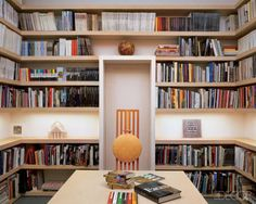 As design legends Lella and Massimo Vignelli do in their Manhattan library.