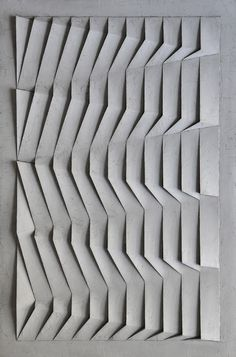 The pattern on this section of wall is very interesting. There is the look of an incut angle because of the shading and there is a repeating angular and sectional repeating lines to create a very effective pattern. Parametrisches Design, Facade Design, Tile Design, Pattern Design, 3d Pattern, Origami Architecture, Architecture Design, Motif Art Deco, Parametric Design