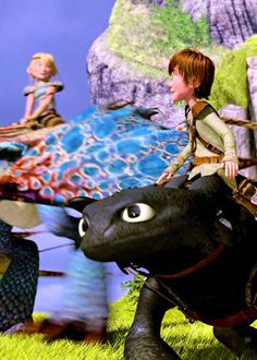 Hiccup and Astrid about to have a dragon race together with their dragons Toothless and Stormfly.