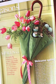 Too cute/easy! Page from Midwest Living mag says tie ribbon on while umbrella's closed, and use floral foam or plastic bag inside for real flowers. Those are blown, painted eggs.  Wire to door hook.