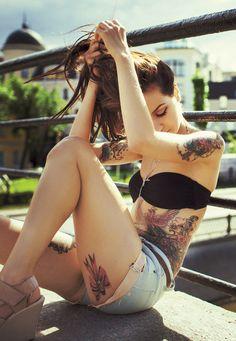 Tattooed girl sitting near a fence. #tattoo #tattoos #ink