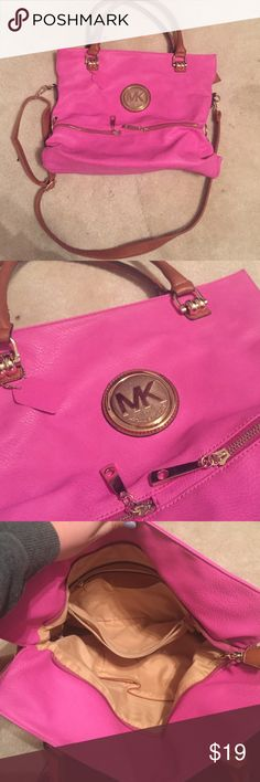 Knock-off Michael Kors purse Pink knock-off Michael Kors purse. Comes with shorts handles and a long strap to be used as a satchel purse! Barely used it, has tons of room on the inside. KORS Michael Kors Bags Crossbody Bags