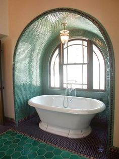 Mediterranean.   Again, a lovely alcove with too bright white porcelain fixtures. It's not the style I don't care for - it's the color of the tub.