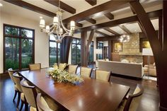 Contemporary Living Room with Exposed beam, stone fireplace, Chandelier, Carpet, Hardwood floors