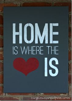 A DIY stenciled canvas sign using the stencil Home Is Where the Heart Is from Cutting Edge Stencils. Wood Pallet Signs, Pallet Art, Diy Signs, Home Signs, Photography Office, Photography Gifts, Cutting Edge Stencils, At Home Workout Plan, Canvas Signs