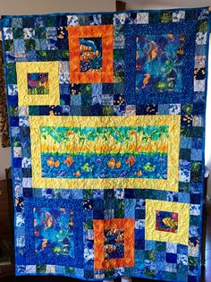 Fish themed baby quilt made by Janet Beyea