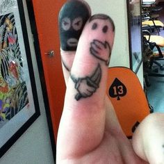 Of the silly, goofy, craziest tats I've seen (to this point), this is the best!  ===  funny finger tattoo