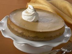 A gingersnap crust and ground ginger in the filling give this festive pumpkin cheesecake rich flavor. #recipe