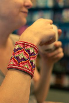 Hand embroidered bargello needlepoint thistle cuff.