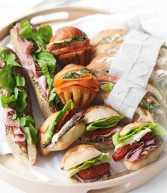 For a relaxed yet romantic date all you need is a bottle of bubbly, a picnic blanket and of course some hand-held snacks.  Picnic Basket of Sandwiches and Rolls recipe | Food | In Season | MiNDFOOD