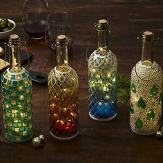 Beautiful Mosaic Glass Wine Bottle Lights Perfect for Indoor or Outdoor Ambiance 4 Assorted Designs in Each Order Ea Wine Bottle Lanterns, Glass Bottle Crafts, Wine Bottle Art, Lighted Wine Bottles, Diy Bottle, Bottle Lights, Painted Bottles, Patron Bottle Crafts, Recycled Glass Bottles