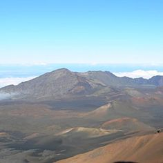 Haleakala Volcano, Maui, Hawaii --  the awesomeness of an above-the-clouds sunrise followed by a 38-mile, switchback-filled bicycle descent of Haleakala volcano.