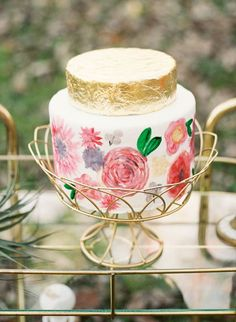 Gold leaf and vibrantly painted flowers come together beautifully in this little cake, created by Buttercup Bakery for the latest Fusion Workshop. | Photo by Emilie Anne Photography