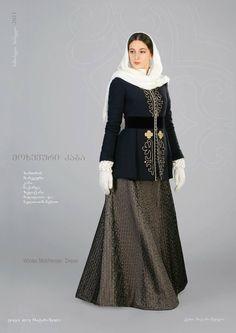 Грузия (Georgia). Еще одно мохевское платье, на этот раз зимнее. Верх с вышивкой и тесьмами. Перчатки и платок на голове вязаные. Ахалуки (сорочка) с стоячим воротником. Пояс из черного бархата.