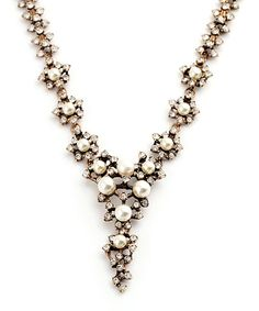 Look at this White Faux Pearl & Crystal Whirlybird Bib Necklace on #zulily today!